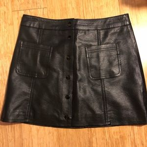 Black pleather button skirt. Divided by H&M